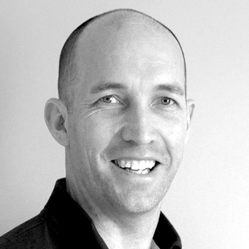 Bedrock Health Communications Strategic Solutions Director, Chris Barton smiling.